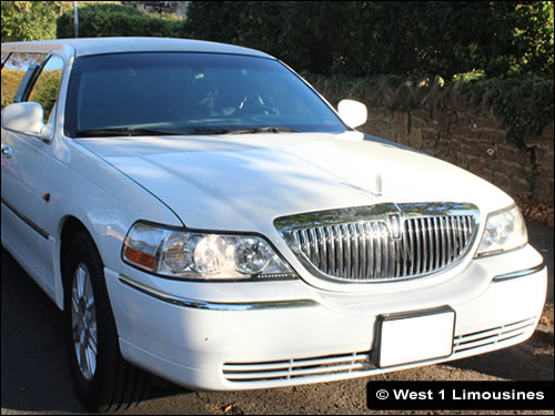 White Lincoln Town Car with eight seats